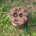 Metal cap of a drill hole, Oak Island
